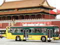Ancient and Modern! A passenger bus passes in front of the Tiananmen Tower at the entrance to the Forbidden City in Beijing.