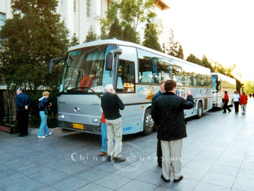 Tourist return to their buses in Beijing for the next stage of their journey.