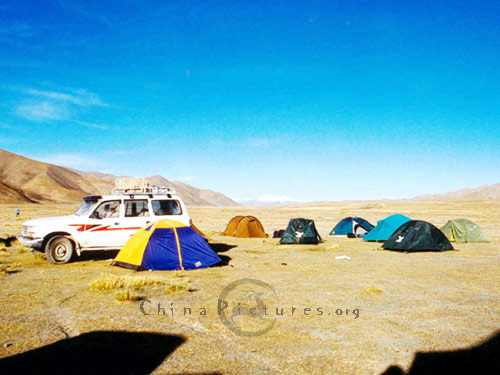 Stopover at the 22th road maintenance squad, Western Tibet. The land cruiser tackles the job that would have taken many pack animals in  times past with considerable ease.