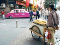 Two-wheeled cart serves as store front for sweet corn bars.