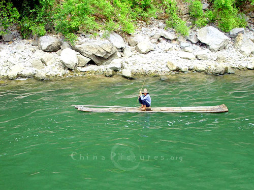 A flat bamboo raft is the ideal means of transport in this  watery wonderland. The gentle flow of the river even takes to raft along without any effort on the part of its passenger.  How unlike life in a modern city!