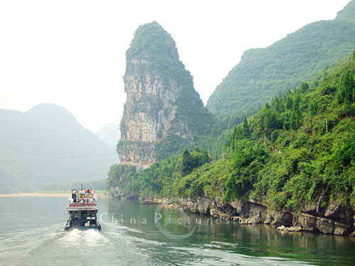 The Li River Cruise passes ever changing scenery, a fresh vista around every twist of the river.