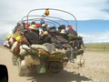 Pilgrims jam into truck en route to Heavenly Namtso Lake.