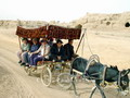 Tourists enjoy donkey cart ride, ancient city of Gaochang, Turpan.