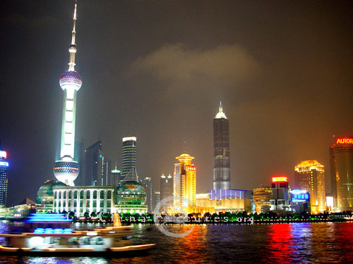 At night, Pudong casts a golden glow upon the river.