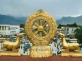 Dharma Wheel symbolizes the unity of all things, spiritual law and Sakyamuni himself in Tibetan Buddhism.