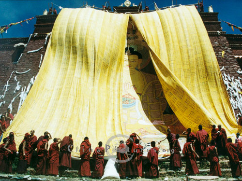 The unveiling ceremony as the portrait of Buddha is displayed to pilgrims visiting the holy site.