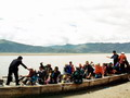 The ferry boat ride to the Samye Monastery is all part of the adventure for these tourists.