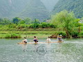 Growing up by the river can be fun. These kids are having a wonderful time with their bamboo raft.