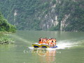These happy tourists are enjoying their water-borne adventure as they travel by motorboat through the Jiuwanxi scenic area, Yichang.