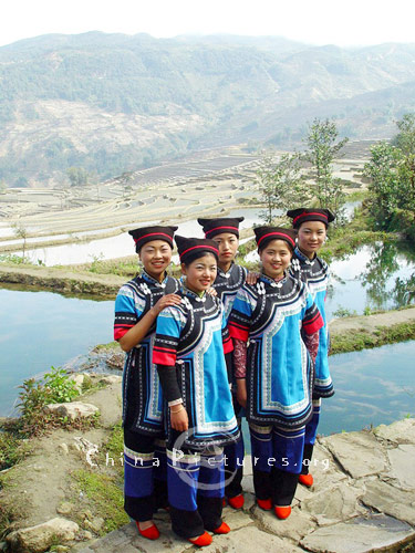Hani minority girls with their ethnic costumes